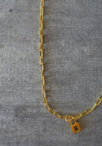 gold padlock and large links chain