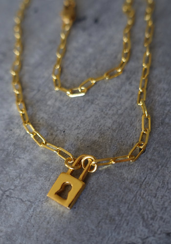gold padlock and large link chain